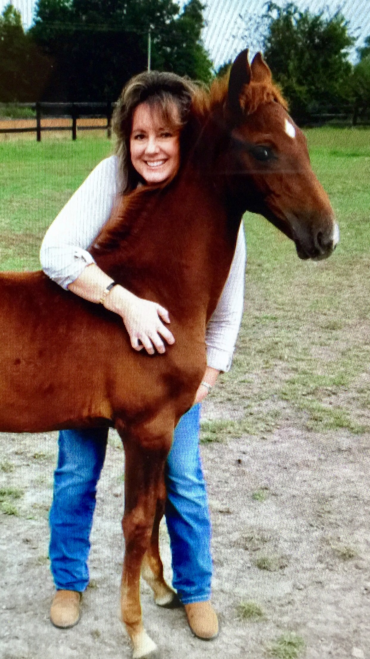 ASR Registrar Lisa Duncan with Winslow, one of the foals she bred.
