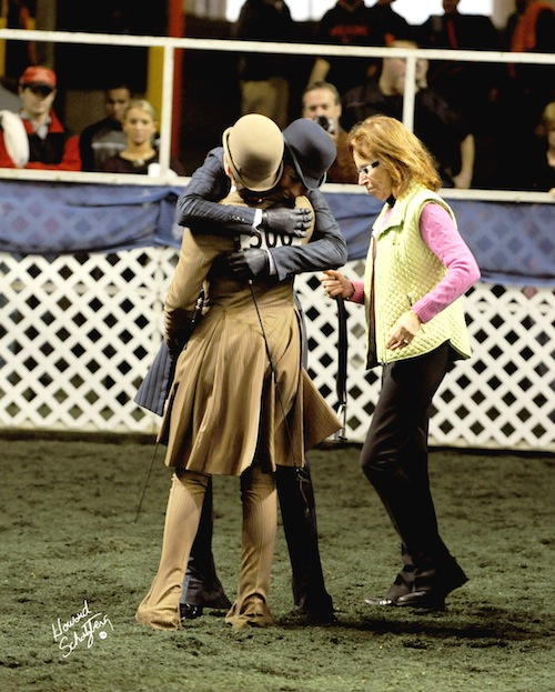 Faye Wuesthofen and Ellen Medley Wright hug each other before switching horses during the USEF Medal Finals in 2009.