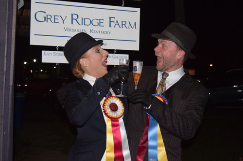 Michael Petty and Michelle Partridge toast each other after taking champion and reserve in the Adult Show Pleasure Championship.