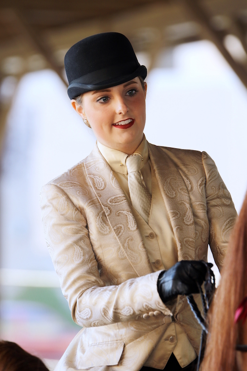 A beautiful turn out for one division can be incorrect attire for another. This suit is absolutely lovely for a performance class but would not be appropriate in equitation. Photo by Julia Shelburne-Hitti.